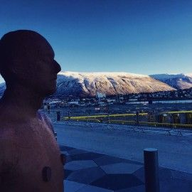 An Anthony Gromley statue in front of the hotel looking out at the mountains.