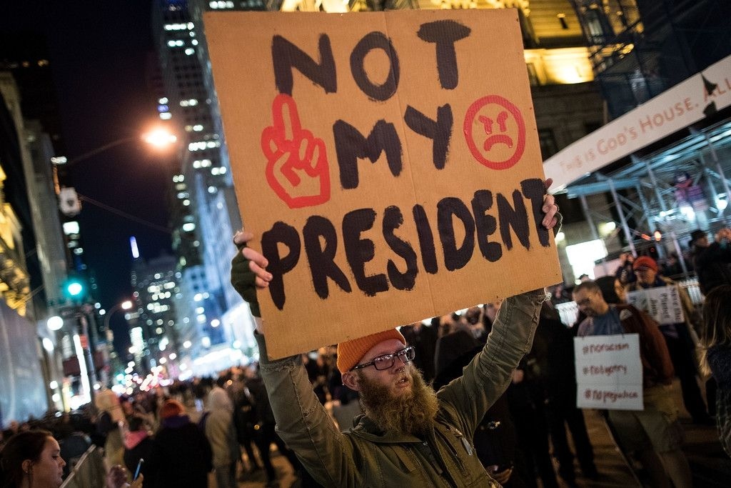 Anti-Donald Trump protesters march in the street on Fifth Avenue, November 11, 2016 in New York City. The election of Trump as president has sparked protests in cities across the country. (Nov. 10, 2016 - Source: Drew Angerer/Getty Images North America)